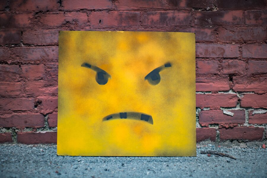 yellow and black smiley wall art